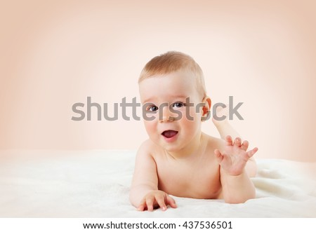 cute eight month old baby lying on soft blanket at home - stock photo