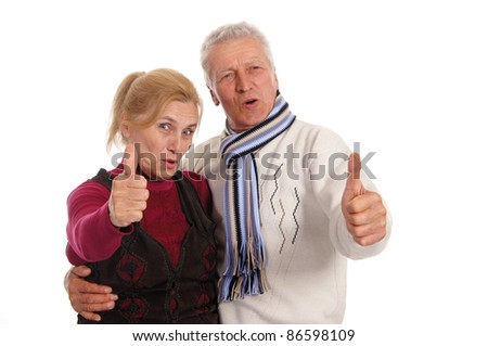 cute elderly couple posing on a white
