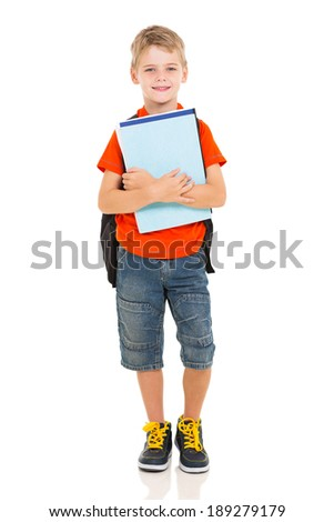 cute elementary school boy holding books on white background - stock photo