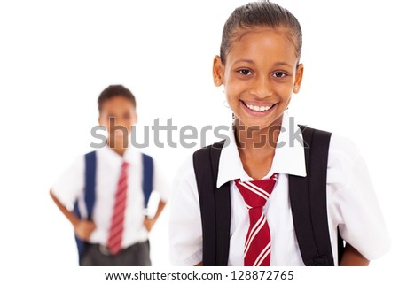 cute elementary schoolgirl in front of clasmate - stock photo