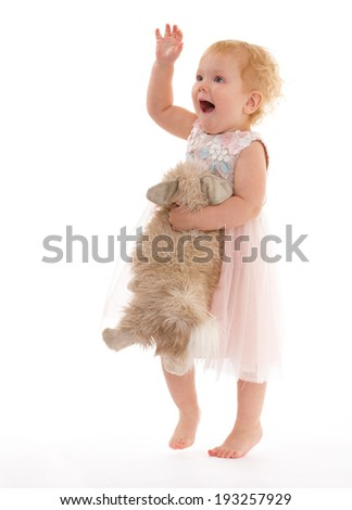 Cute emotional girl with a toy dog - stock photo