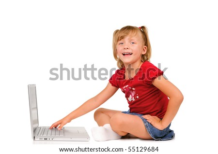 Cute excited little girl with a laptop
