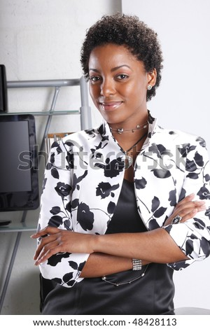 Cute executive standing confident - stock photo