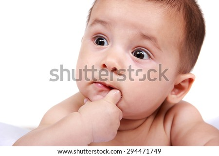 cute expressions of baby sucking his little fingers isolated in white - stock photo