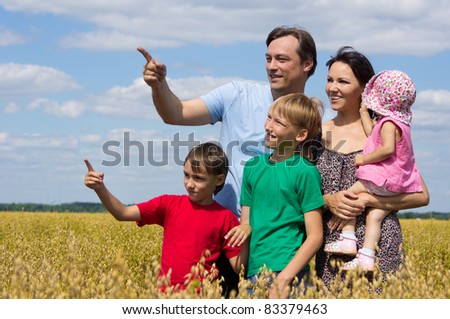 cute family of a five playing at field
