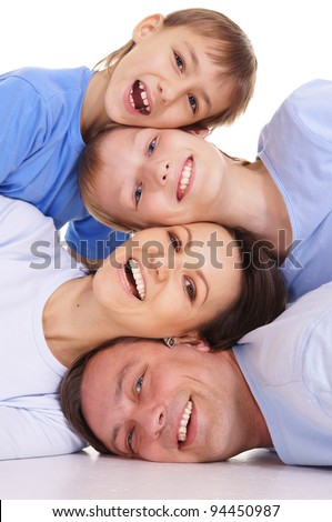 cute family of a four in blue clothes - stock photo
