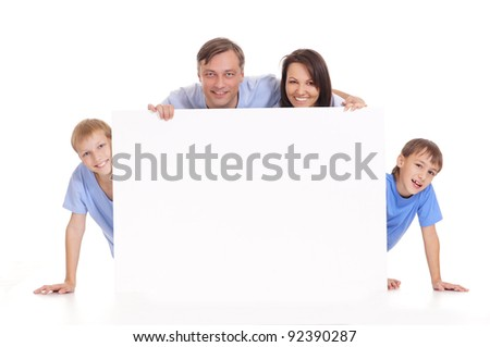 cute family of a four with board