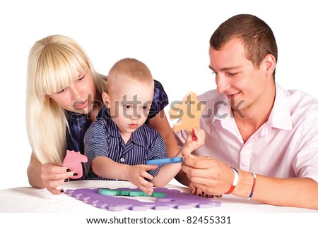 cute family of a three playing at table