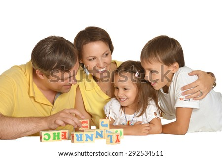 Cute family  playing on a white background - stock photo