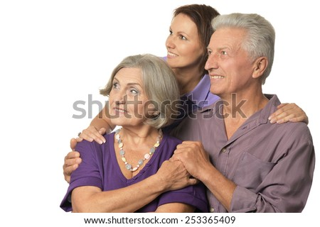Cute family portrait , adult daughter with senior parents - stock photo