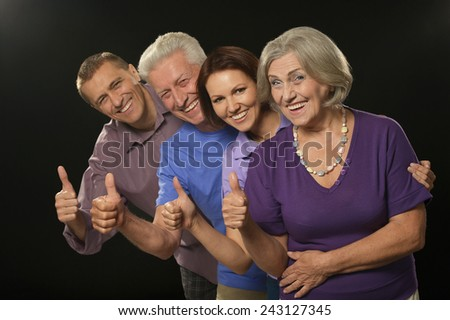 Cute family portrait with senior parents