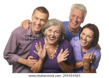 Cute family portrait with senior parents - stock photo