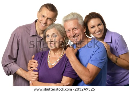 Cute family portrait with senior parents on a white background