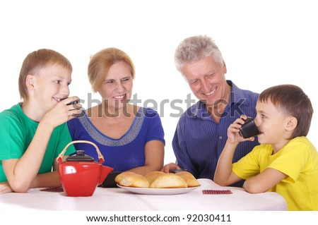 cute family sitting at table with buns
