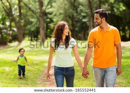 cute family walking in the park - stock photo
