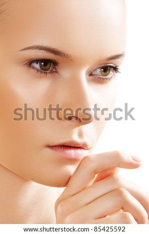 Cute fashion girl with natural make-up on white background. Perfect skin condition, natural spa look
