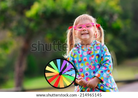 Cute fashion kid in a glasses outdoor - stock photo