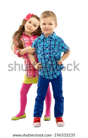 Cute fashion kids are standing together, on the white background . Fashionable and friendship concept - stock photo