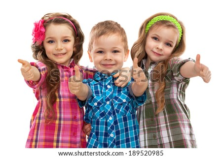 Cute fashion kids showing thumbs up, on the white background . Fashionable and friendship concept - stock photo
