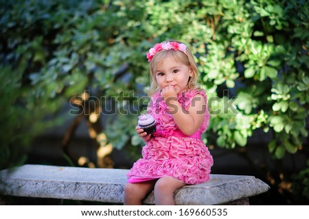 cute fashion little girl eat happy birthday pink cupcake