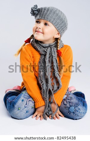Cute fashionable girl in warm clothes - stock photo