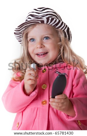 Cute fashionable kid with lipstich and mirror - stock photo