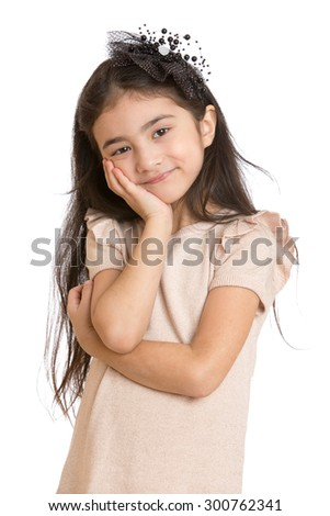 Cute fashionable little dark-haired girl with beautiful hair on his head. The girl is dressed in a long grey dress,close-up-Isolated on white background - stock photo