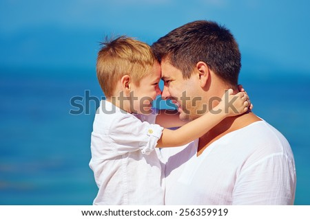 cute father and son embracing, family relationship - stock photo