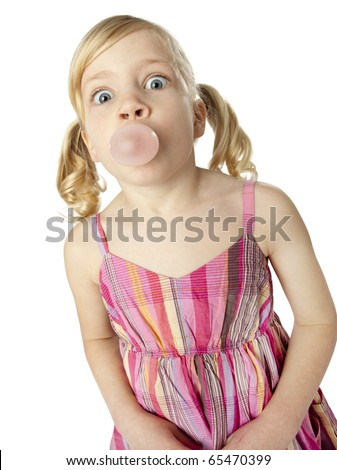 Cute female child blowing bubble with gum, wide-eyed, humorous facial expression, shot on white background.