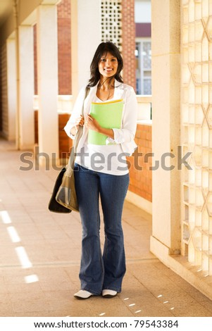 cute female college student in school building - stock photo