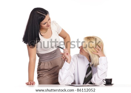 cute female couple posing at table on white