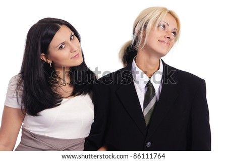 cute female couple posing on a white