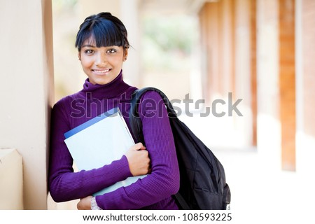 cute female teen indian high school student portrait in school - stock photo