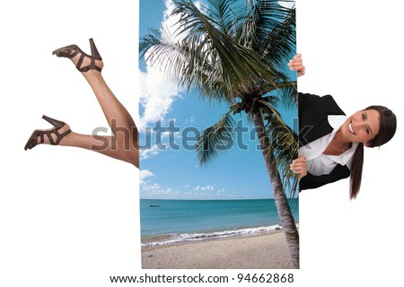 cute female travel agent flying under poster of beautiful island - stock photo