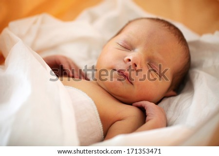 Cute four-day old baby boy asleep - stock photo