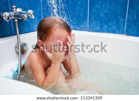 Cute four year old girl taking a relaxing bath. The symbol of purity and hygiene education. - stock photo