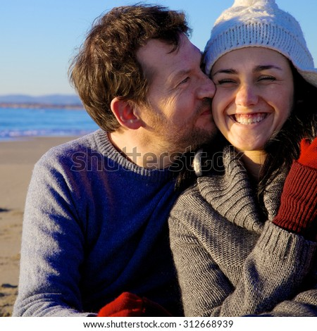 Cute fresh couple in love smiling happy in front of beach