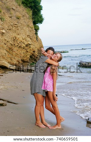 Cute friend hugs by the sea