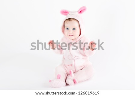 Cute funny baby dressed as an Easter bunny - stock photo