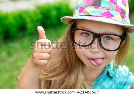cute funny girl with glasses and hat posing for a photograph - stock photo