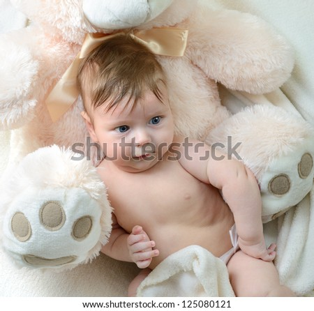 cute funny infant baby boy with big bear, beautiful kid's portrait closeup - stock photo