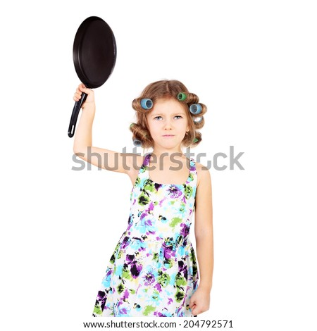 cute funny little emotional girl in curlers and with the pan - stock photo