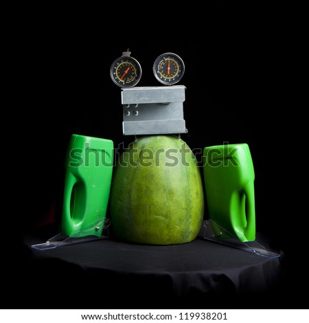 cute funny robot toy made of garbage. recycling waste - stock photo