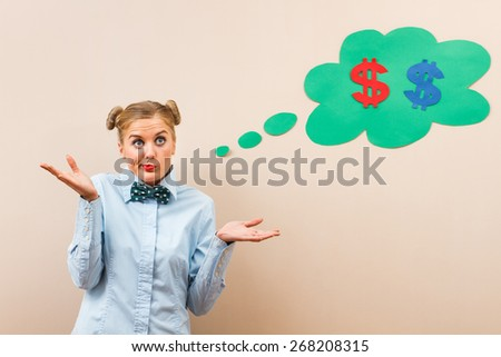 Cute geek girl is trying to find solution for her money problems.How to reduce costs - stock photo