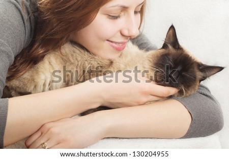 cute girl affectionately hugging  kitten - stock photo
