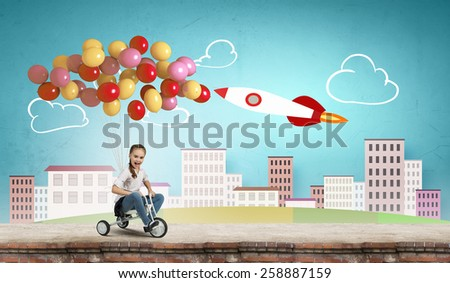Cute girl against drawn background riding three wheeled bike - stock photo