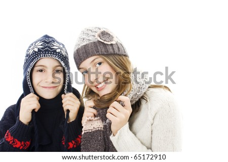 Cute girl and boy winter portrait. Isolated on white.