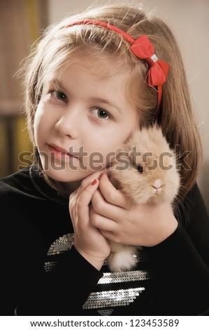 Cute  girl and the little bunny hug - stock photo