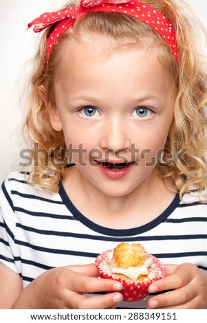 Cute girl anticipating eating her treat - stock photo