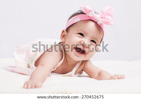 cute girl baby shooting in studio at Thailand - stock photo